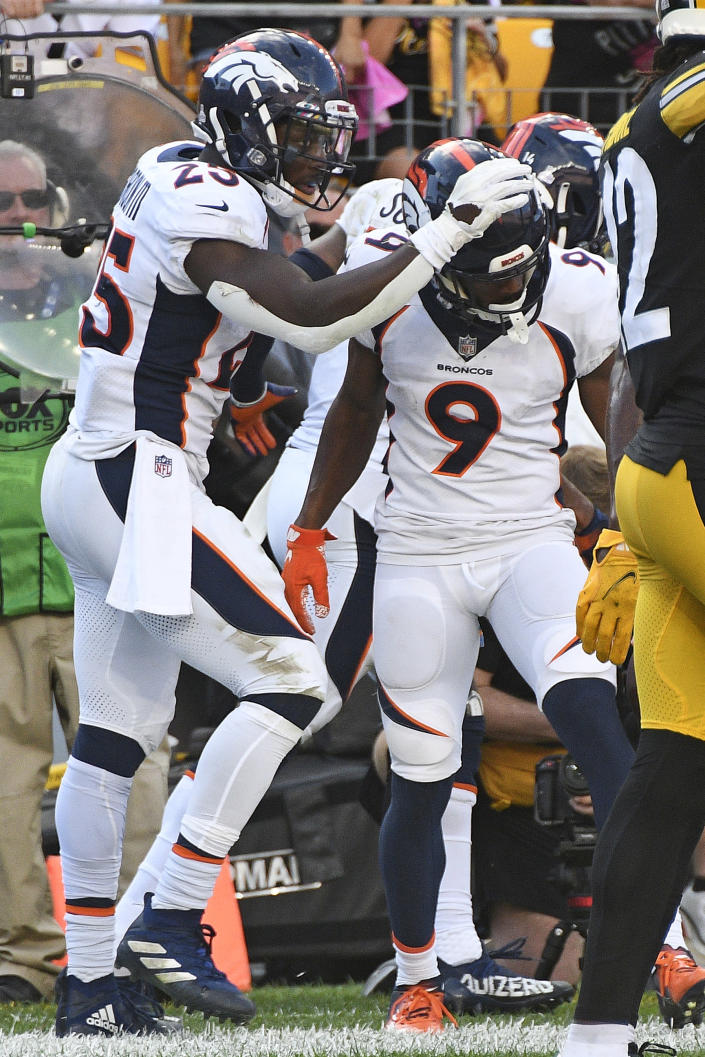 Denver Broncos wide receiver Kendall Hinton (9) celebrates with Melvin Gordon (25) after scoring a touchdown on a pass from quarterback Teddy Bridgewater during the second half of an NFL football game against the Pittsburgh Steelers in Pittsburgh, Sunday, Oct. 10, 2021. (AP Photo/Don Wright)
