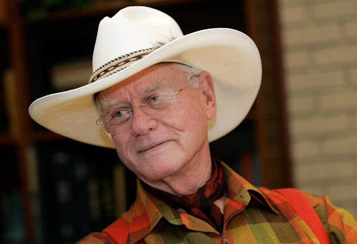 """In this Thursday, Oct. 9, 2008 photo, actor Larry Hagman listens to a reporter's question while visiting the Southfork Ranch in Parker, Texas, made famous in the television show """"Dallas."""" Actor Larry Hagman, who for more than a decade played villainous patriarch JR Ewing in the TV soap Dallas, has died at the age of 81, his family said Saturday Nov. 24, 2012(AP Photo/Tony Gutierrez)"""
