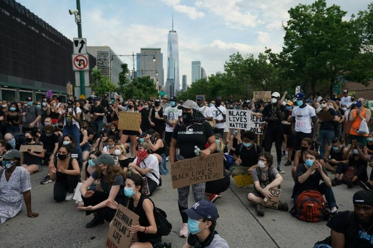 Protesters sit on the road during a peaceful protest against police brutality and racism in New York