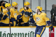 Nashville Predators center Ryan Johansen (92) celebrates after scoring the winning goal during a shootout in an NHL hockey game between the Predators and the Dallas Stars Sunday, April 11, 2021, in Nashville, Tenn. The Predators won 3-2. (AP Photo/Mark Humphrey)