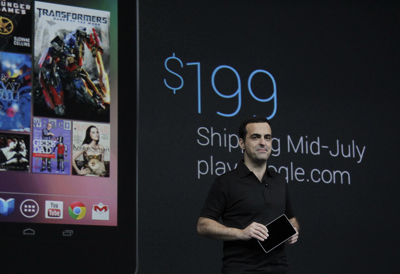 Hugo Barra, Director of Google Product Management holds up the new Google Nexus7, that will sell for $199 and be available in mid-July, at the Google I/O conference in San Francisco, Wednesday, June 27, 2012.  The tablet will have a screen that measures 7 inches diagonally, smaller than the nearly 10 inches on Apple Inc.ís popular iPad. That means itís more likely to challenge Amazon.com Inc.ís Kindle Fire, which is also 7 inches.   (AP Photo/Paul Sakuma)