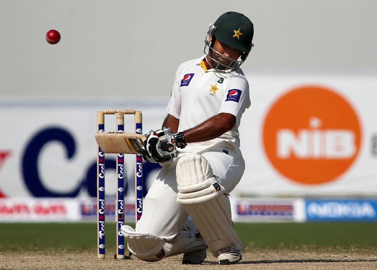 Batsman Asad Shafiq of Pakistan avoids a bouncer during the fourth day of the second Test cricket match between Pakistan and South Africa in Dubai on October 26, 2013. AFP PHOTO/MARWAN NAAMANI        (Photo credit should read MARWAN NAAMANI/AFP/Getty Images)