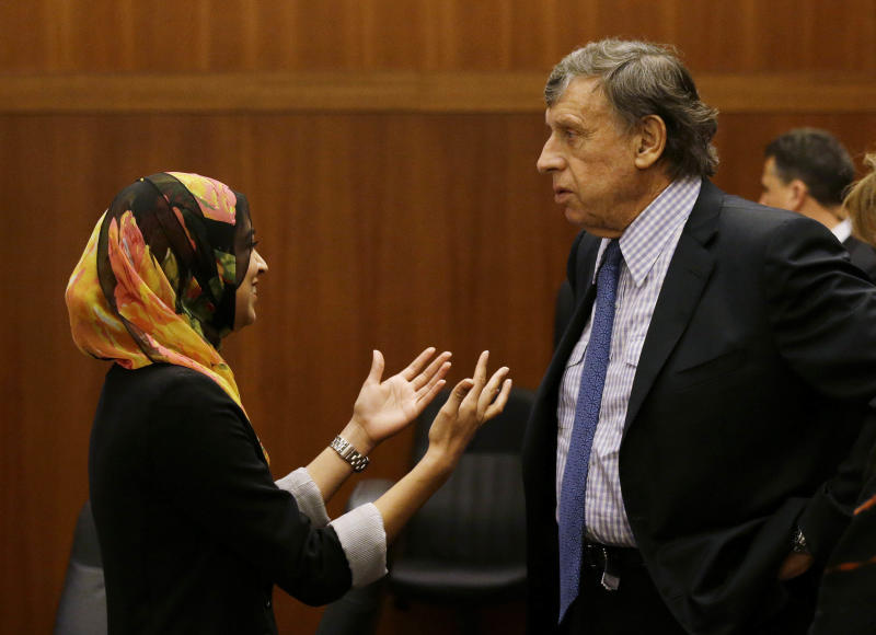 Sadia Saifuddin, left, talks with regent Richard Blum, right, after her confirmation at a University of California Board of Regents meeting Wednesday, July 17, 2013 in San Francisco. The University of California's governing board confirmed the first practicing Muslim student member to the board on Wednesday, despite opposition from some Jewish groups. UC regents voted in favor of UC Berkeley student Sadia Saifuddin's nomination. Blum abstained from the vote. (AP Photo/Eric Risberg)
