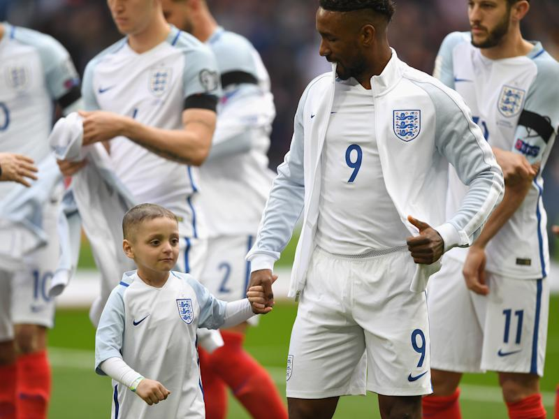 Bradley Lowery holding Jermain Defoe's hand before kick-off: Getty