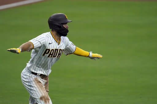 San Diego Padres' Eric Hosmer reacts after hitting a grand slam during the fifth inning of a baseball game against the Texas Rangers, Thursday, Aug. 20, 2020, in San Diego. (AP Photo/Gregory Bull)