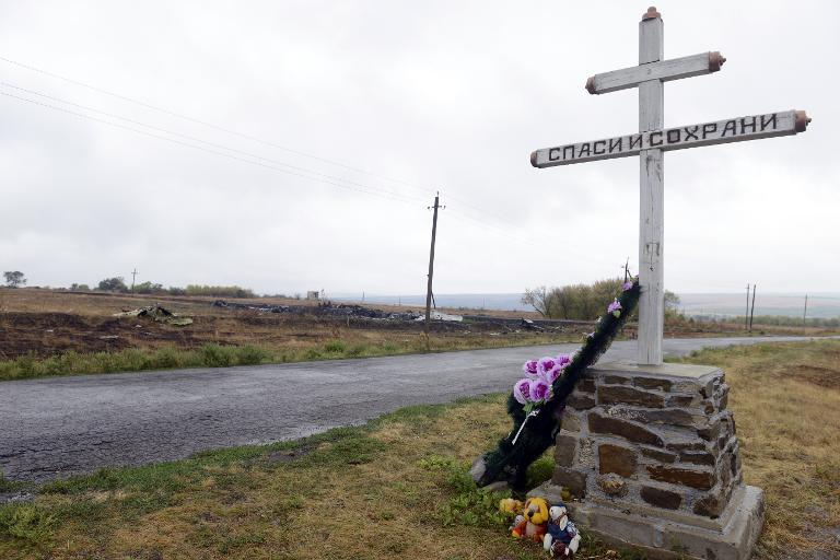 Flowers and soft toys left at a monument for the Malaysia Airlines Flight MH17 crash in the village of Hrabove (Grabovo), on September 9, 2014