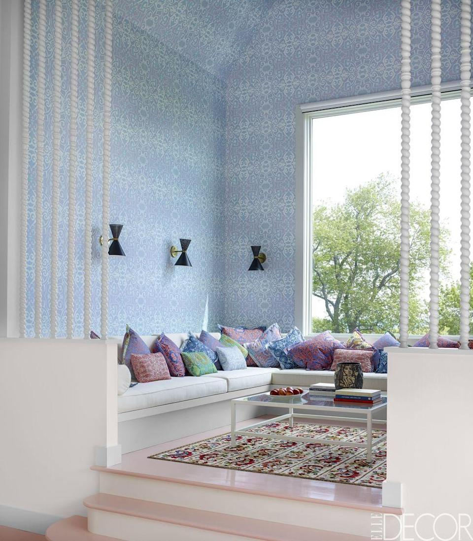 """<p>Peek inside this minimalist, <a href=""""https://www.elledecor.com/design-decorate/house-interiors/a8824/pool-house-ideas/"""" rel=""""nofollow noopener"""" target=""""_blank"""" data-ylk=""""slk:Moroccan-inspired pool house"""" class=""""link rapid-noclick-resp"""">Moroccan-inspired pool house</a> in New York. In the raised sitting area, the patterned wallpaper and cushion fabrics are by Nancy Kintisch and the sconces are by Atelier de Troupe.</p><p><em>Still Waters Wallpaper, $118<br></em><a class=""""link rapid-noclick-resp"""" href=""""https://go.redirectingat.com?id=74968X1596630&url=https%3A%2F%2Fwww.anthropologie.com%2Fshop%2Fstill-waters-wallpaper%3Fcolor%3D040%26size%3DOne%2BSize%26inventoryCountry%3DUS%26countryCode%3DUS%26mrkgcl%3D694%26mrkgadid%3D3339968734%26adtype%3Dpla%26product_id%3D49959240%26adpos%3D2o16%26creative%3D348156566303%26device%3Dc%26network%3Dg%26gclid%3DCjwKCAjw8NfrBRA7EiwAfiVJpcY_Pg4Byd_PtMOhKXoHXsiPHgAUGh4xN8MpPFIugiEu-j7CZ1qCgxoCGoAQAvD_BwE%26gclsrc%3Daw.ds%26type%3DSTANDARD%26quantity%3D1&sref=https%3A%2F%2Fwww.redbookmag.com%2Fhome%2Fg35083191%2Fwallpaper-design-ideas%2F"""" rel=""""nofollow noopener"""" target=""""_blank"""" data-ylk=""""slk:Shop the Look"""">Shop the Look</a></p>"""