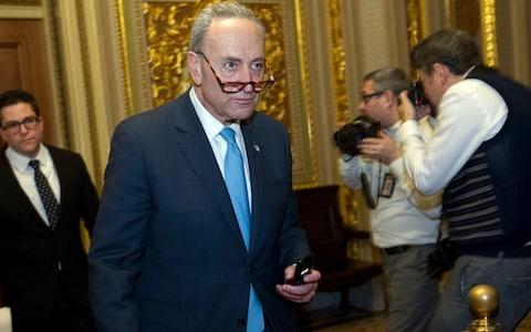 Sen. Charles Schumer walks to the chamber after a closed meeting with fellow democrats on Capitol Hill - Credit: AP