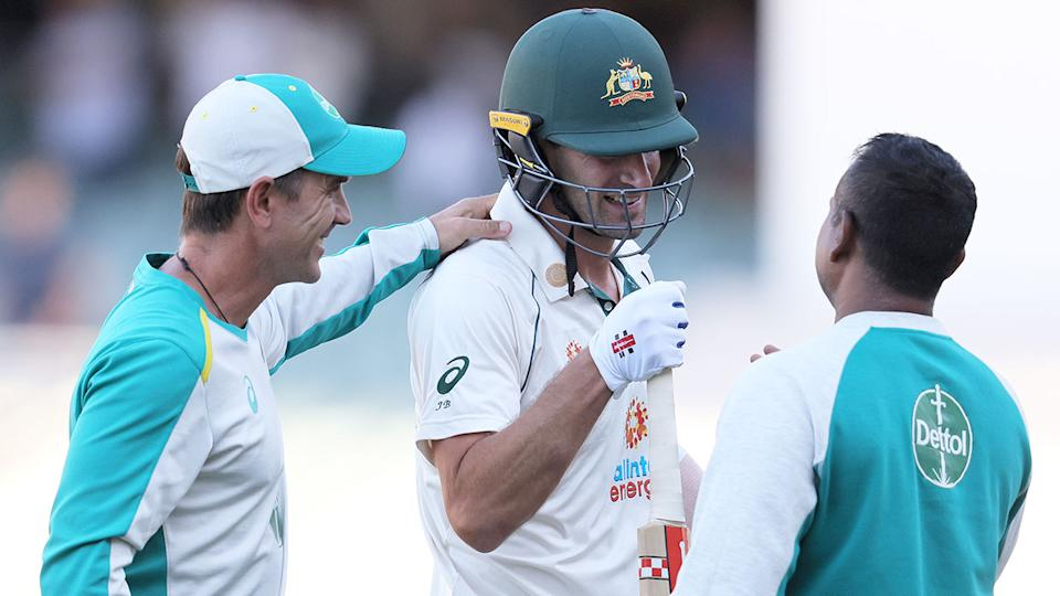 Joe Burns is seen here being congratulated by Australia's coach in the first Test.