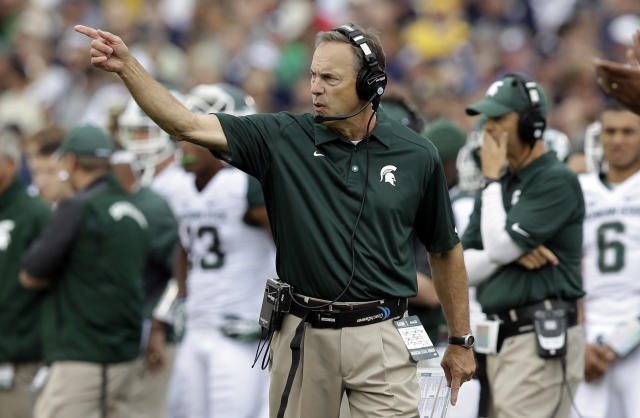 Michigan State head coach Mark Dantonio yells to his team as they played Notre Dame during the first half of an NCAA college football game in South Bend, Ind., Saturday, Sept. 21, 2013. (AP Photo/Michael Conroy)