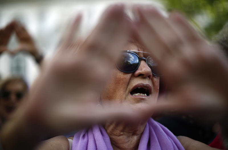 "A woman protests after Spain's top court found five men known as the ""La Manada,"" or ""The Animal Pack"" guilty of rape outside the Supreme Court in Madrid, Spain, Friday, June 21, 2019. Spain's Supreme Court on Friday overruled two lower courts and sentenced five men to 15 years in prison each for raping an 18-year-old woman. (AP Photo/Manu Fernandez)"