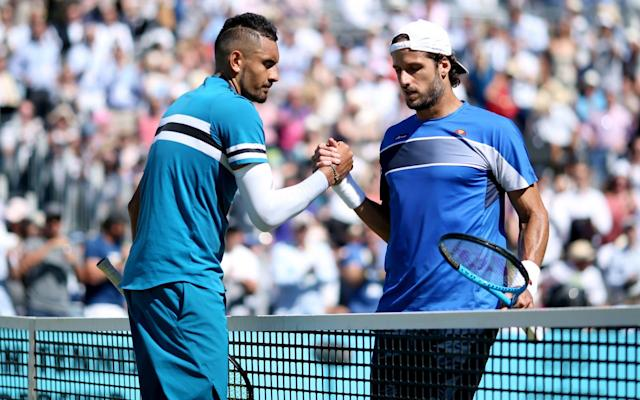 """Nick Kyrgios won his way through to the semi-finals at Queen's on Friday after edging two tie-breaks in a service stalemate against defending champion Feliciano Lopez. Lopez, 36, was successful with 90 per cent of his first serves but to no avail. The Australian produced aces on 50 per cent of his service wins, a total of 32, for the second match in a row at the tournament. Both sets were defined by dominant serving, with the receiver getting little of a look in. Kyrgios became mildly frustrated in the second set by the incessant strong serves coming his way, not even pretending to try on a couple of points. When the rallies did come, Lopez was cool at the net, moving better than an opponent who is 13 years his junior. But neither could capitalise on the handful of break points they were afforded and both sets were pushed to tie-breaks, where Kyrgios stepped his game up in, fittingly taking match point on a 136mph ace. Kyrgios said afterwards that he hardly practises his service. """"I will never go out on the practice court and hit serves just for the sake of hitting serves,"""" he said. """"I didn't expect to serve the way I did but I just found my rhythm early again in this match. But I felt like I had to. He served way better than he did in Stuttgart when I played him last week."""" Novak Djokovic is also through to the Queen's semis Credit: Getty Images Kyrgios sat out the clay season to rest his elbow and hip, which have troubled him over the past year, and said he felt in shape for Wimbledon. """"I definitely feel like my preparation for Wimbledon maybe hasn't been this good before,"""" he said. """"I have never won a round [at Queen's]. I have always gone into Wimbledon maybe a little bit underdone match-wise. I have played a lot of matches, which is maybe something that can help me."""" Kyrgios now faces top seed Marin Cilic, who beat Sam Querrey in straight sets, in Saturday's semi-final. Novak Djokovic also progressed after coming from a break down in the first set to beat Adria"""