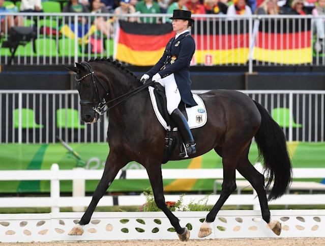 Germany's Isabell Werth on Weihegold Old performs her routine during the equestrian dressage Grand Prix team final on August 12, 2016 (AFP Photo/John MacDougall)
