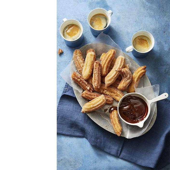 "<p>These homemade mini churros pair perfectly with dark chocolate sauce and some espresso.<br></p><p><em><a href=""https://www.womansday.com/food-recipes/food-drinks/a23459296/churros-with-chocolate-caramel-sauce-recipe/"" rel=""nofollow noopener"" target=""_blank"" data-ylk=""slk:Get the recipe for Churros with Chocolate-Caramel Sauce."" class=""link rapid-noclick-resp"">Get the recipe for Churros with Chocolate-Caramel Sauce. </a></em></p>"