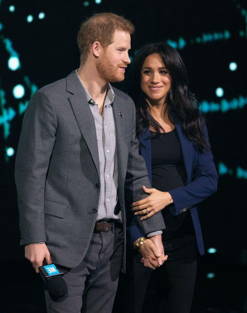 "<p>Harry and Meghan also squeezed in a double hand hold while<a href=""https://www.townandcountrymag.com/society/tradition/a26710388/meghan-markle-surprise-appearance-prince-harry-we-day/"" rel=""nofollow noopener"" target=""_blank"" data-ylk=""slk:on stage"" class=""link rapid-noclick-resp""> on stage</a> on WE Day.</p>"