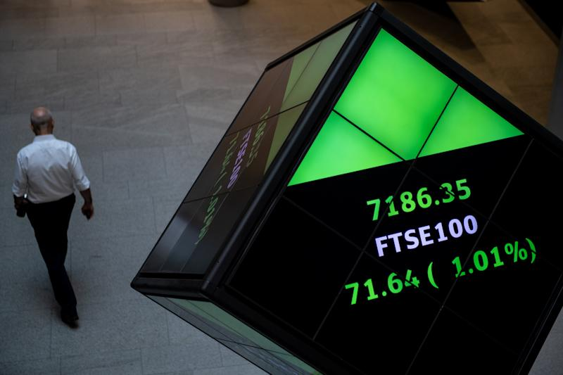 LONDON, ENGLAND - AUGUST 29: Financial market figures are shown on big screens and a ticker in the main entrance at London Stock Exchange on August 29, 2019 in London, England. The pound has come under renewed pressure after the government moved to prorogue parliament for five weeks, fueling fears of a no-deal Brexit. (Photo by Chris J Ratcliffe/Getty Images)