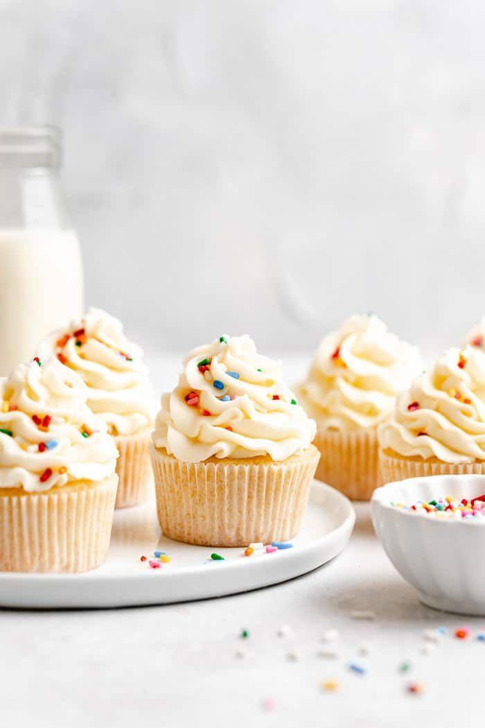 """<p>Celebrate America's birthday with the ultimate birthday cupcake: classic vanilla! You can even dress these up with red, white, and blue sprinkles. </p><p><strong>Get the recipe at <a href=""""https://grandbaby-cakes.com/vanilla-cupcakes-recipe/"""" rel=""""nofollow noopener"""" target=""""_blank"""" data-ylk=""""slk:Grandbaby Cakes"""" class=""""link rapid-noclick-resp"""">Grandbaby Cakes</a>.</strong></p><p><a class=""""link rapid-noclick-resp"""" href=""""https://go.redirectingat.com?id=74968X1596630&url=https%3A%2F%2Fwww.walmart.com%2Fsearch%2F%3Fquery%3DPIONEER%2BWOMAN%2BPLATTERS&sref=https%3A%2F%2Fwww.thepioneerwoman.com%2Ffood-cooking%2Frecipes%2Fg36343624%2F4th-of-july-cupcakes%2F"""" rel=""""nofollow noopener"""" target=""""_blank"""" data-ylk=""""slk:SHOP PIONEER WOMAN PLATTERS"""">SHOP PIONEER WOMAN PLATTERS </a></p>"""