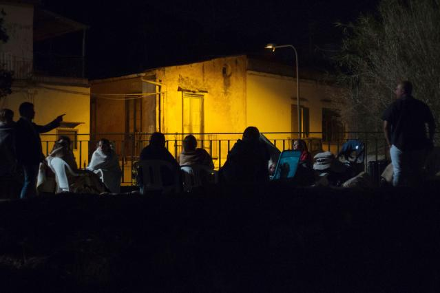 <p>People gather and wait in a street, early morning in Ischia, on Aug. 22, 2017, after an earthquake hit the popular Italian tourist island off the coast of Naples, causing several buildings to collapse overnight. (Photo: Eliano Imperato/AFP/Getty Images) </p>