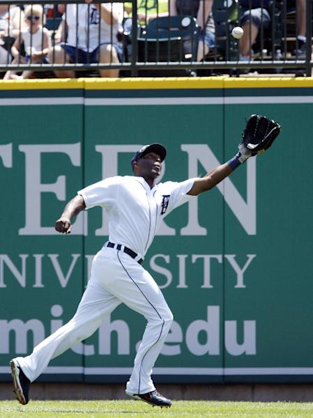 Detroit Tigers right fielder Torii Hunter reaches out to catch a fly ball hit by Texas Rangers' Elvis Andrus in the fifth inning of a baseball game Sunday, July 14, 2013, in Detroit. (AP Photo/Duane Burleson)