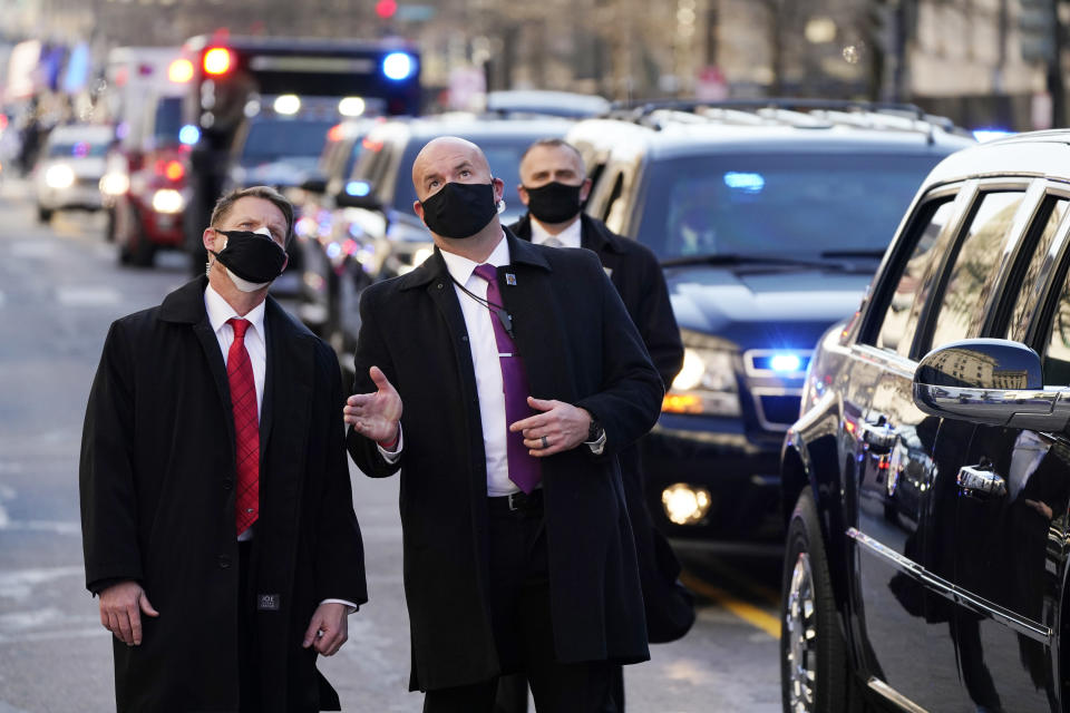 Security look upward as Vice President Kamala Harris, and her husband Doug Emhoff, ride during the Inauguration Day Parade Route in Washington, Wednesday, Jan. 20, 2021, after being sworn in as the 46th vice president of the United States. (AP Photo/Jacquelyn Martin)