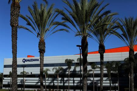 FILE PHOTO: A building on the Qualcomm campus is seen, as chip maker Broadcom Ltd announced an unsolicited bid to buy peer Qualcomm Inc for $103 billion, in San Diego, California, U.S. November 6, 2017. REUTERS/Mike Blake/File Photo