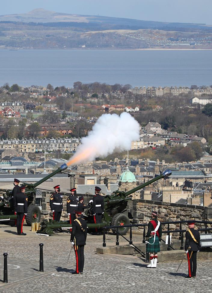 Image: Members of the 105th Regiment Royal Artillery fire a 41-round gun salute at Edinburgh Castle in Scotland (WPA Pool / Getty Images)