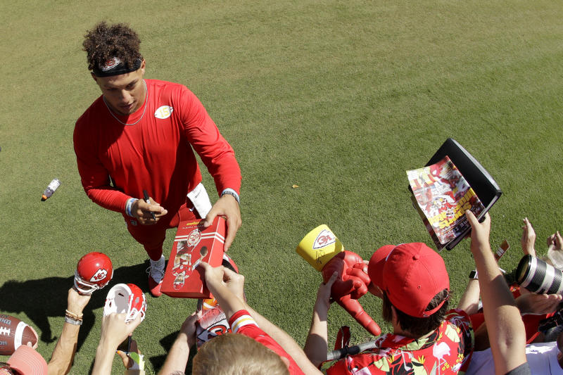Kansas City Chiefs quarterback Patrick Mahomes signs autographs for fans after practice. (AP)