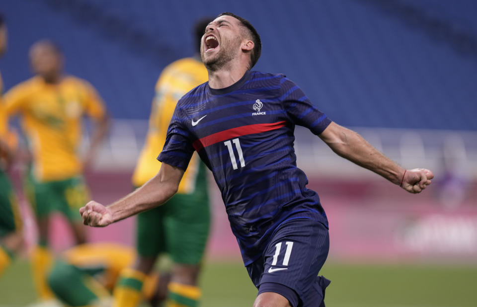France's Teji Savanier celebrates after scoring a goal during a men's soccer match against South Africa at the 2020 Summer Olympics, Sunday, July 25, 2021, in Saitama, Japan. (AP Photo/Martin Mejia)