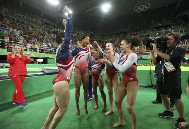 2016 Rio Olympics - Artistic Gymnastics - Final - Women's Team Final - Rio Olympic Arena - Rio de Janeiro, Brazil - 09/08/2016. (L-R) Alexandra Raisman (USA) of USA (Aly Raisman), Gabrielle Douglas (USA) of USA (Gabby Douglas), Simone Biles (USA) of USA, Madison Kocian (USA) of USA and Laurie Hernandez (USA) of USA celebrate winning gold in the women's team final. REUTERS/Mike Blake FOR EDITORIAL USE ONLY. NOT FOR SALE FOR MARKETING OR ADVERTISING CAMPAIGNS.