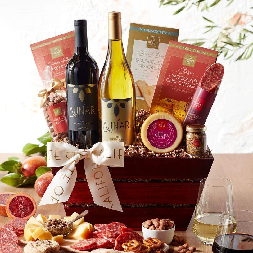 """<p>hickoryfarms.com</p><p><a href=""""https://go.redirectingat.com?id=74968X1596630&url=https%3A%2F%2Fwww.hickoryfarms.com%2Fgift-baskets%2Fwine%2Fcalifornia-getaway-wine-gift-basket-007650.html&sref=https%3A%2F%2Fwww.townandcountrymag.com%2Fleisure%2Fdining%2Fg29328884%2Fbest-wine-cheese-gift-baskets%2F"""" rel=""""nofollow noopener"""" target=""""_blank"""" data-ylk=""""slk:Shop Now"""" class=""""link rapid-noclick-resp"""">Shop Now</a></p><p>Get happy hour started right with this antipasto-ready basket. Cheese and salami, crackers and tapenade, nuts, pretzels, and cookies all finished off with two bottles of California vino in the states most celebrated styles—cabernet sauvignon and chardonnay—make for the perfect way to finish off a long workweek... or pretty much any other time. </p>"""