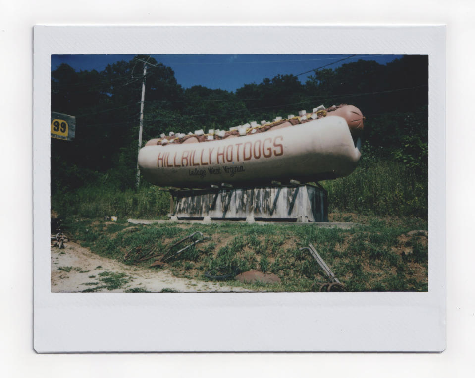 A giant hotdog replica stands on the side of a highway in Lesage, W.Va., Wednesday, July 29, 2020. (AP Photo/Wong Maye-E)