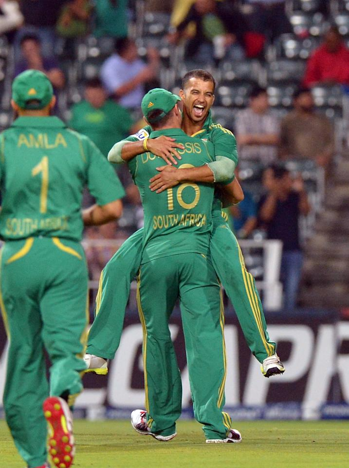 South Africa's cricketer Jean-Paul Duminy (R) celebrates with teammates after taking a wicket during the first T20 cricket match between South Africa and Pakistan at the Wanderers Stadium in Johannesburg on November 20, 2013.  AFP PHOTO / ALEXANDER JOE        (Photo credit should read ALEXANDER JOE/AFP/Getty Images)