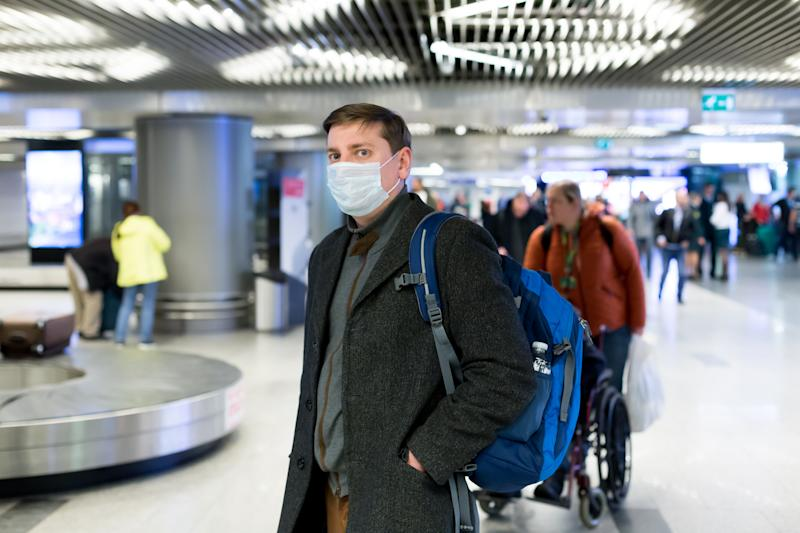 man, corona, virus, airport, mask, 2019-ncov, backpack, suitcase, afraid, wheels, passenger, blue, caucasian, china, chinese, coat, coronavirus, crowd, customs, dangerous, disease, disposable, epidemic, european, face mask, flu, flu epidemic, frightened, health care, illness, infection, influenza, medical, pneumonia, protection, protective, public, respiratory, respiratory diseases, safety, sick, transport, transportation, travel, underground, virus protection, wuhan, young, 2019, N-CoV