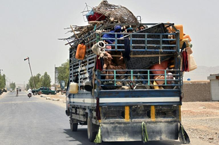 The Taliban have captured a key district in their former bastion of Kandahar, sending scores of families fleeing from the area