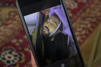 Emal Ahmadi shows a photo of his family member who was killed during a U.S. drone strike on their home last Sunday, , at his home in Kabul, Afghanistan, Thursday, Sept. 2, 2021. Ahmadi says Sunday's U.S. drone strike killed 10 members of his family, six of them children. Senior U.S. military officials said the drone strike hit an Islamic State target and disrupted the extremist' ability to further disrupt the final phase of the U.S. withdrawal from Afghanistan. (AP Photo/Khwaja Tawfiq Sediqi)