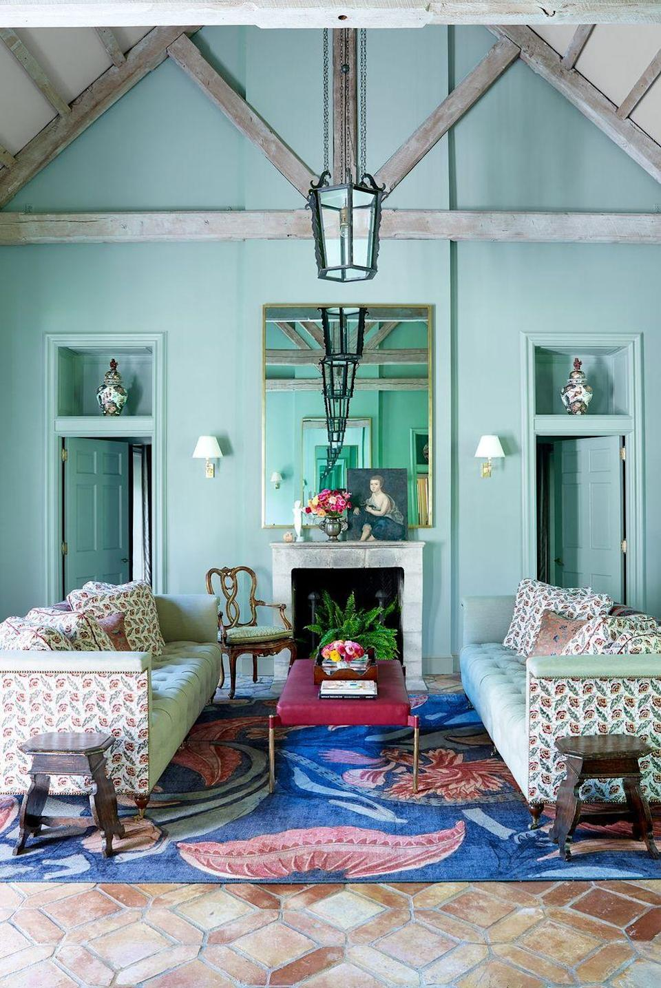 """<p>Channel a lush tropical oasis, as <a href=""""http://jaynedesignstudio.com/team/william-cullum/"""" rel=""""nofollow noopener"""" target=""""_blank"""" data-ylk=""""slk:Thomas Jayne and William Cullum"""" class=""""link rapid-noclick-resp"""">Thomas Jayne and William Cullum</a> did, with this fresh color. In a living room where the paint stretches all the way up to the rafters, the hue changes depending on the way the light hits it, shifting between sharp mint and soft sea foam green. </p>"""
