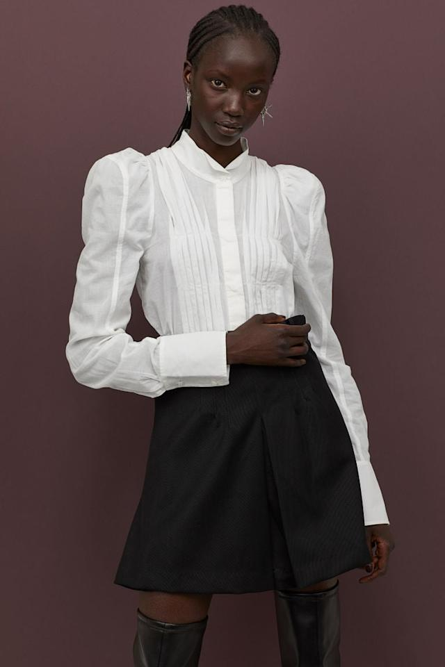 """<p>This <a href=""""https://www.popsugar.com/buy/HampM-Cotton-Puff-sleeved-Blouse-487704?p_name=H%26amp%3BM%20Cotton%20Puff-sleeved%20Blouse&retailer=www2.hm.com&pid=487704&price=70&evar1=fab%3Aus&evar9=46580340&evar98=https%3A%2F%2Fwww.popsugar.com%2Fphoto-gallery%2F46580340%2Fimage%2F46580342%2FHM-Cotton-Puff-sleeved-Blouse-Flared-Wool-blend-Skirt&list1=shopping%2Ch%26m%2Cfall%20fashion%2Cfall&prop13=api&pdata=1"""" rel=""""nofollow"""" data-shoppable-link=""""1"""" target=""""_blank"""" class=""""ga-track"""" data-ga-category=""""Related"""" data-ga-label=""""https://www2.hm.com/en_us/productpage.0789379001.html"""" data-ga-action=""""In-Line Links"""">H&amp;M Cotton Puff-sleeved Blouse</a> ($70) and <a href=""""https://www.popsugar.com/buy/Flared-Wool-blend-Skirt-487854?p_name=Flared%20Wool-blend%20Skirt&retailer=www2.hm.com&pid=487854&price=80&evar1=fab%3Aus&evar9=46580340&evar98=https%3A%2F%2Fwww.popsugar.com%2Fphoto-gallery%2F46580340%2Fimage%2F46580342%2FHM-Cotton-Puff-sleeved-Blouse-Flared-Wool-blend-Skirt&list1=shopping%2Ch%26m%2Cfall%20fashion%2Cfall&prop13=api&pdata=1"""" rel=""""nofollow"""" data-shoppable-link=""""1"""" target=""""_blank"""" class=""""ga-track"""" data-ga-category=""""Related"""" data-ga-label=""""https://www2.hm.com/en_us/productpage.0789367001.html"""" data-ga-action=""""In-Line Links"""">Flared Wool-blend Skirt</a> ($80) can take you anywhere you need to go.</p>"""