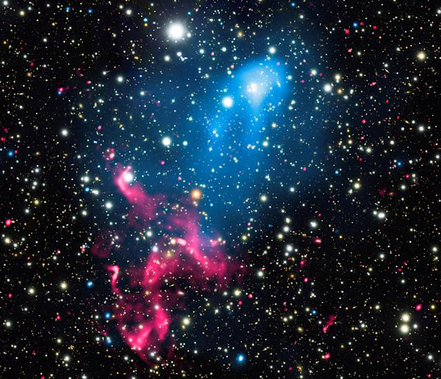 <p>A composite image released by NASA on Jan. 5, 2017 contains X-rays from Chandra (blue), radio emission from the GMRT (red), and optical data from Subaru (red, green, and blue) of the colliding galaxy clusters called Abell 3411 and Abell 3412. (Photo: NASA/Chandra X-ray Observatory/Handout via Reuters) </p>