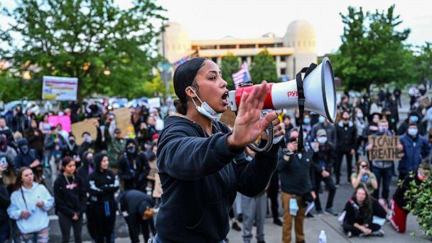 PHOTO: Organizer Renee White speaks to a group Black Lives Matter protesters gathered at the Spokane County Courthouse Sunday night, June 7, 2020. The death of George Floyd at the hands of police in Minneapolis has sparked protests for police reform. (Colin Mulvany/AP)
