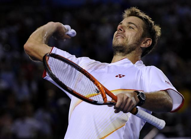 Stanislas Wawrinka of Switzerland throws his wristband to the spectators after defeating Tomas Berdych of the Czech Republic during their semifinal at the Australian Open tennis championship in Melbourne, Australia, Thursday, Jan. 23, 2014.(AP Photo/Andrew Brownbill)