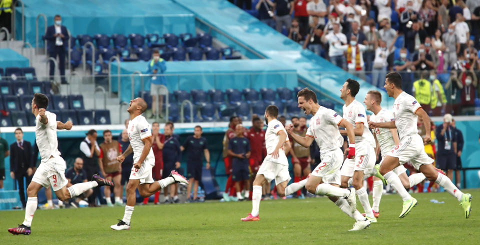 Spain players celebrates after the Euro 2020 soccer championship quarterfinal match between Switzerland and Spain, at the Saint Petersburg stadium in Saint Petersburg, Friday, July 2, 2021. (Maxim Shemetov /Pool Photo via AP)