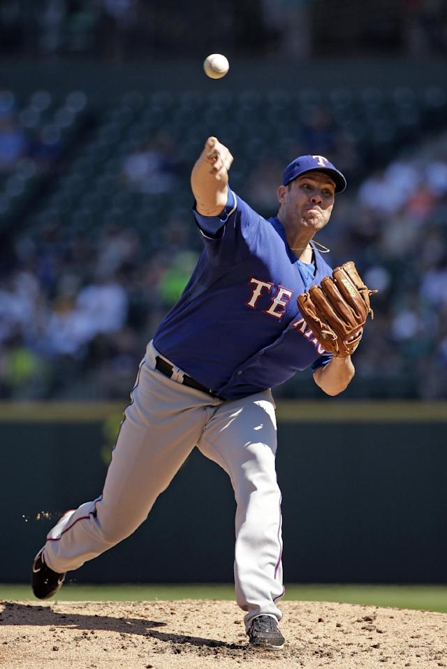 Texas Rangers starting pitcher Colby Lewis throws against the Seattle Mariners in the second inning of a baseball game Wednesday, Aug. 27, 2014, in Seattle. AP Photo/Elaine Thompson)