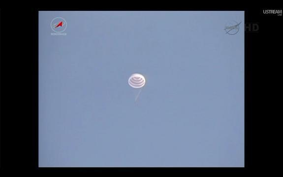 The Soyuz TMA-22 capsule carrying NASA astronaut Dan Burbank and Russian cosmonauts Anton Shkaplerov and Anatoly Ivanishin shortly before it landed in Kazakhstan on April 27, 2012.