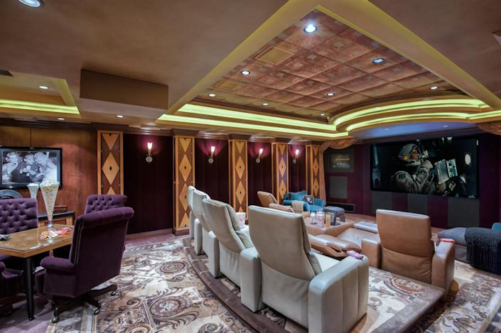 """<p>Among the property's more arresting features is this screening room with seating for 16 and three screens, plus a purified air system to clean out the smell when cigar aficionados light up. (All photos via <a href=""""http://bit.ly/1OjQdjg"""" rel=""""nofollow noopener"""" target=""""_blank"""" data-ylk=""""slk:Concierge Auctions listing"""" class=""""link rapid-noclick-resp"""">Concierge Auctions listing</a>)</p>"""