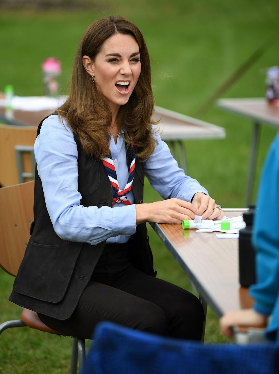 Britain's Catherine, Duchess of Cambridge talks with members of the Beavers as she visits a Scout Group in Northolt, northwest London on September 29, 2020, where she joined Cub and Beaver Scouts in outdoor activities. - The Duchess learned how the Scouts have adapted during the COVID-19 pandemic, and continued Scouting sessions and online activities. (Photo by Daniel LEAL-OLIVAS / various sources / AFP) (Photo by DANIEL LEAL-OLIVAS/AFP via Getty Images)