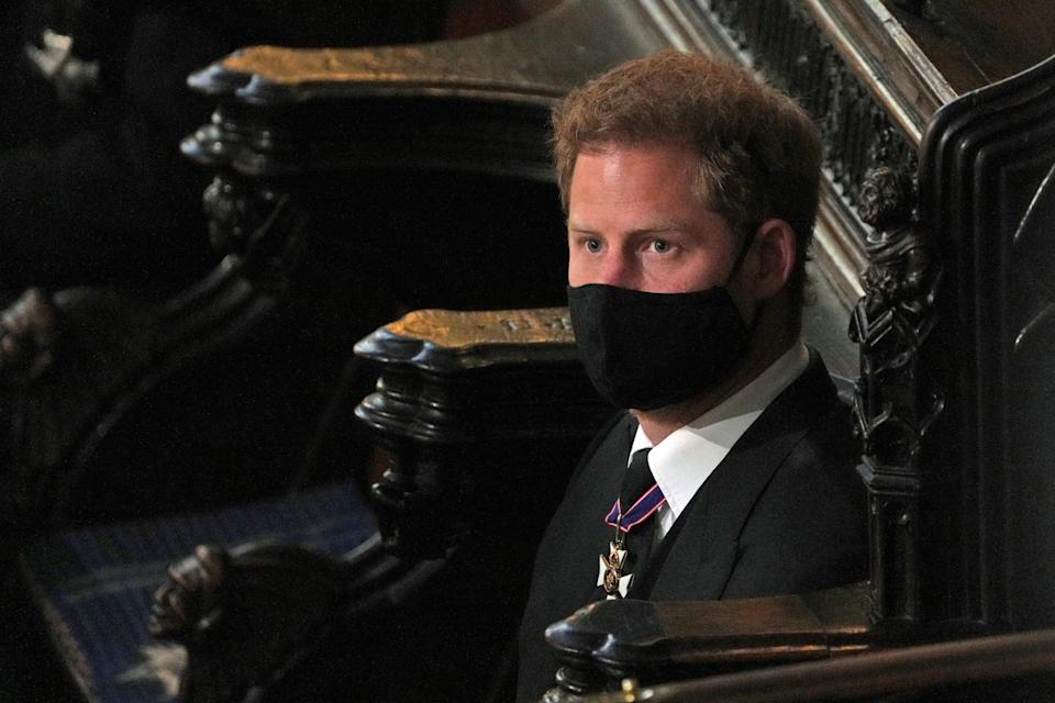 Prince Harry of Britain, Duke of Sussex attends the funeral service of Prince Philip of Britain, Duke of Edinburgh at St George's Chapel at Windsor Castle, Windsor, west of London, on April 17, 2021. - Philip, who was married to ' Queen Elizabeth II, aged 73, died on April 9 at the age of 99 a few weeks after a month-long stay in hospital for treatment of a heart condition and infection.  (Photo by Yui Mok / POOL / AFP) (Photo by YUI MOK / POOL / AFP via Getty Images)