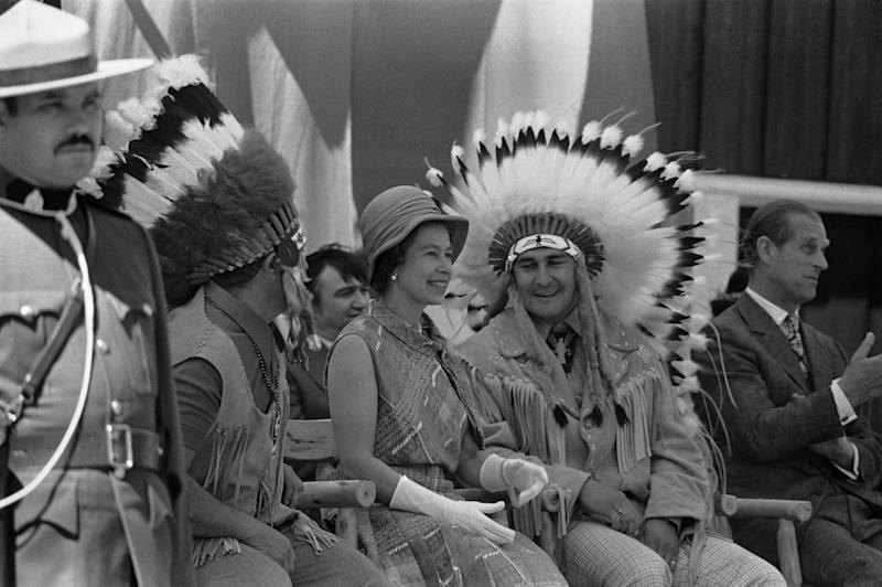 "FILE In this July 3, 1973 photo, Chief Frank Pelletier is shown with Britain's Queen Elizabeth II in Thunder Bay, Ontario, as she views the display of Appaloosa horses and aboriginal Canadian traditional dancing.  Decades have passed since Canadians replaced ""God Save the Queen"" with ""O Canada,"" but royalty-lovers are in for a thrill Thursday, June 30, 2011,  when Prince William and his bride come visiting.  Those who leaf through the country's updated citizenship guide will find the oath of allegiance to Queen Elizabeth II is now at the front.  The pamphlet is a reflection of something deeper ,   Prime Minister Stephen Harper's ambition to foster a conservative national identity in which the royal connection plays a key role. (AP Photo)"