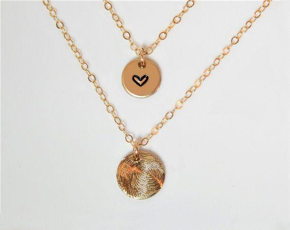 "Get them this cute necklace from <a href=""https://www.etsy.com/listing/494362239/fingerprint-necklace-actual-fingerprint?gpla=1&gao=1&utm_campaign=shopping_us_SimpleAndLayered_sfc_osa&utm_medium=cpc&utm_source=google&utm_custom1=0&utm_content=10230423&gclid=Cj0KCQjwvabPBRD5ARIsAIwFXBk41m9IdDraLV1wNNOphXFtZUTuoLYh32l3FM8G0nocM_p6m_MNllgaAgR3EALw_wcB"" target=""_blank"">Etsy</a> to celebrate the new birth in a fashionable but endearing way."