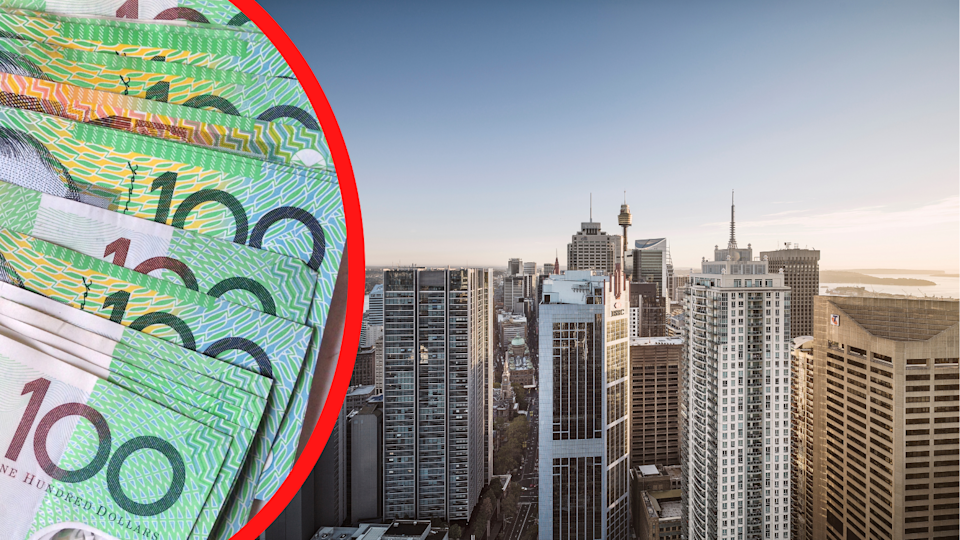 Australian $100 notes fanned out and the skyline of the Sydney CBD.