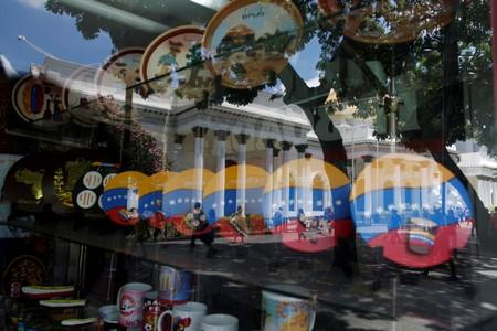 National Assembly building is reflected in a window of a store in Caracas